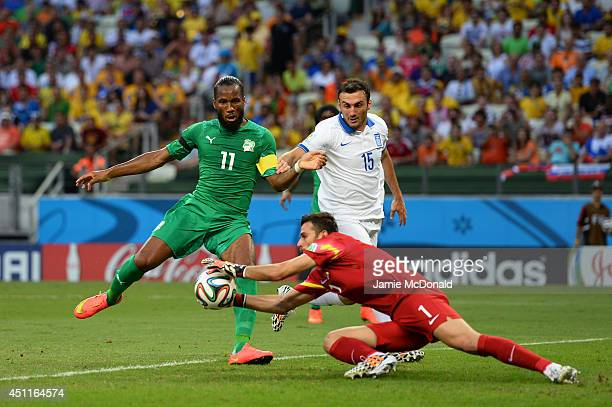 Orestis Karnezis of Greece makes a save against Didier Drogba of the Ivory Coast during the 2014 FIFA World Cup Brazil Group C match between Greece...