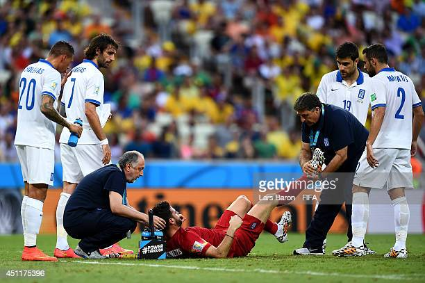 Orestis Karnezis of Greece receives treatment during the 2014 FIFA World Cup Brazil Group C match between Greece and Cote D'Ivoire at Estadio...
