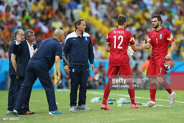 Orestis Karnezis of Greece shakes hands with Panagiotis Glykos as he is replaced due to an injury during the 2014 FIFA World Cup Brazil Group C match...