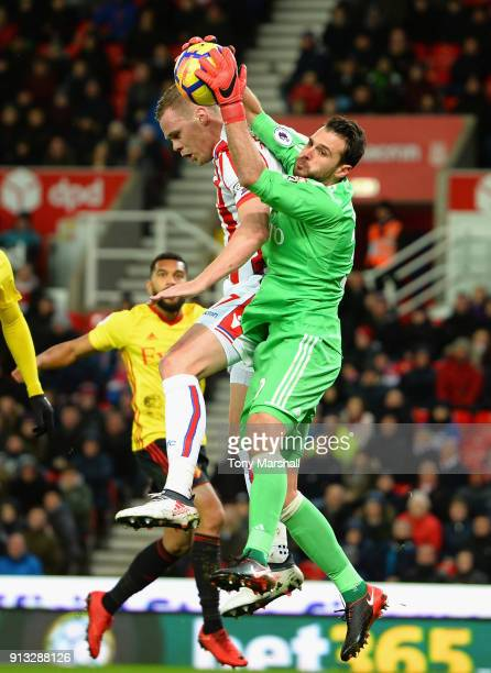 Orestis Karnezis of Watford makes a save from Ryan Shawcross of Stoke City during the Premier League match between Stoke City and Watford at Bet365...