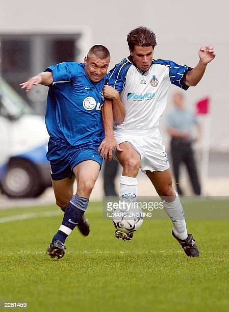 Orests Buitkus of Skonto Riga fights for the ball with Carlo Mamo of Sliema Wanderers during their UEFA Champions League match in Riga 23 July 2003...