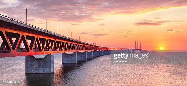 oresundsbron bridge at sunset - malmo stock pictures, royalty-free photos & images