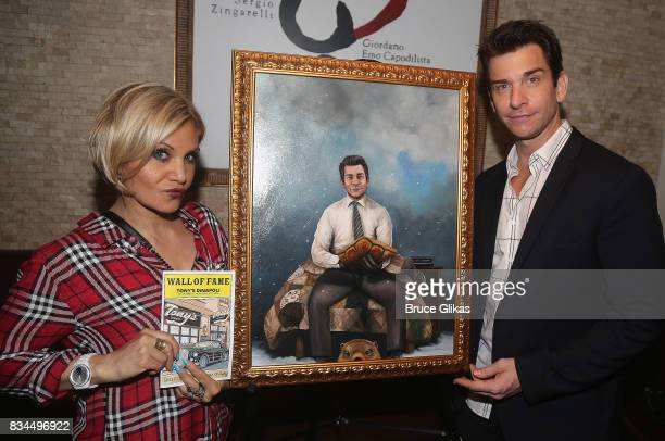 Orfeh and husband Andy Karl pose at the Broadway Wall of Fame unveiling to honor Andy Karl for his role in Groundhog Day at Tony's di Napoli...