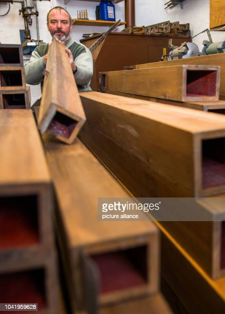Organ builder Andreas Arnold blowing into one of the big wooden whistles in his workshop in Plau am See Germany 22 January 2016 For 50 years the...