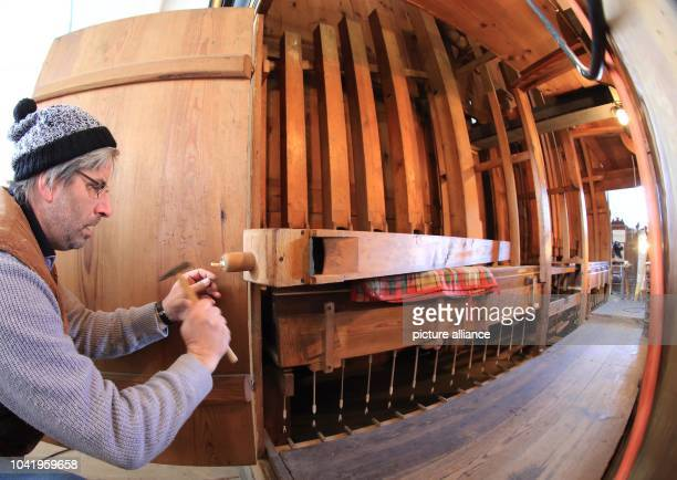 Organ builder Guido Bahlke works on the organ in the protestant church 'Sankt Marien' in Gardelegen Germany 26 March 2013 He is fighting mould...
