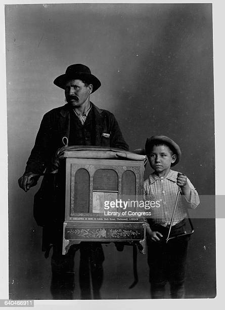 Organ Grinder and Child Playing Triangle