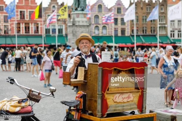 organ grinder, brugge, belgium - music box stock pictures, royalty-free photos & images