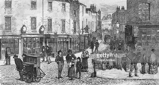 Organ Grinders headquarters in the Italian quarter near Hatton Garden, London. Original Publication: The Graphic - pub. 1875