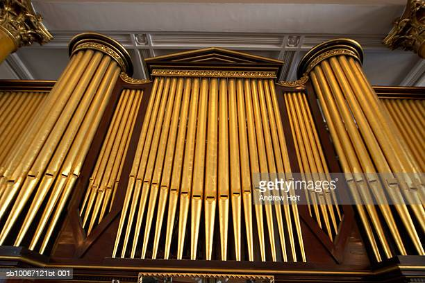 organ in church, low angle view - church organ stock pictures, royalty-free photos & images
