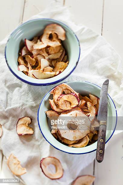 organic apple crisps in bowls, studio - dried food stock pictures, royalty-free photos & images
