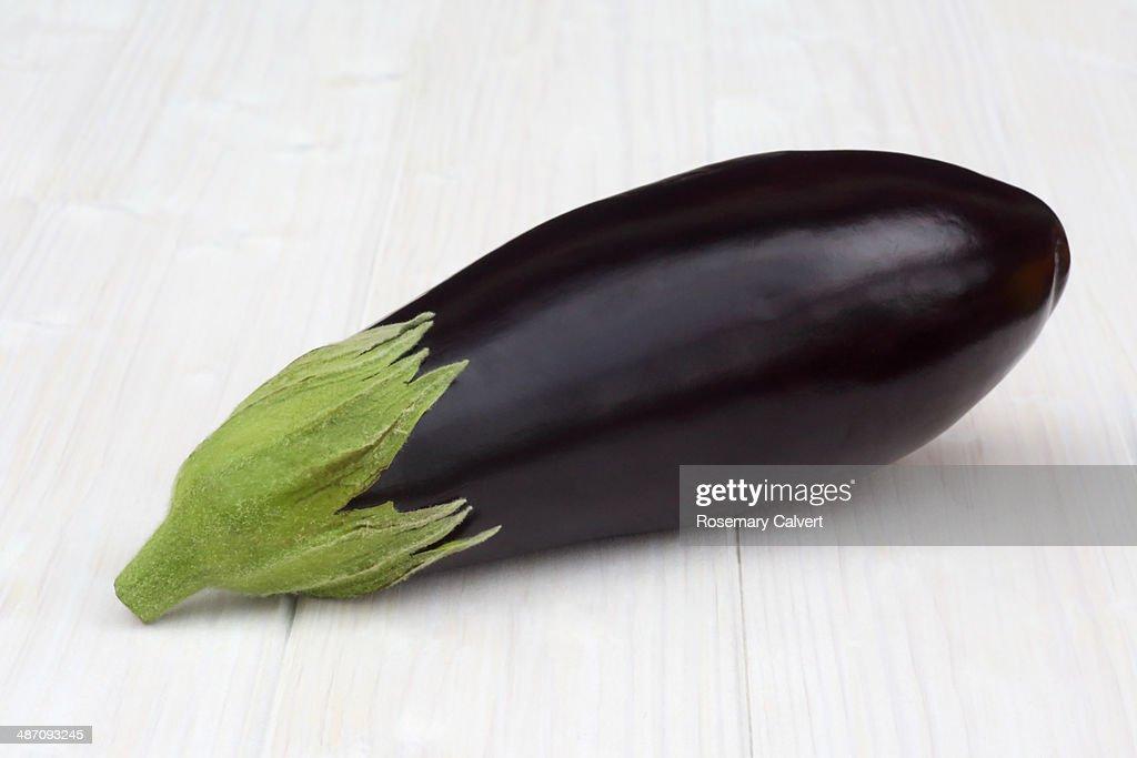 Organic aubergine on white background : Stock Photo