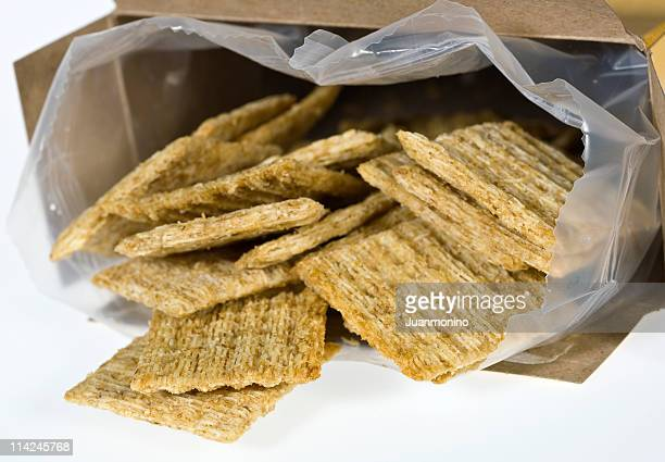 organic baked whole grain wheat crackers - cracker snack stock photos and pictures