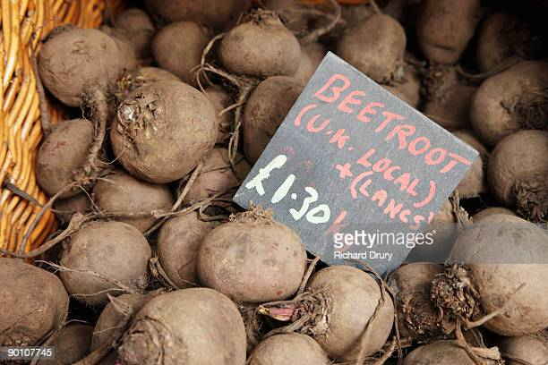 organic beetroot on market stall - richard drury stock pictures, royalty-free photos & images