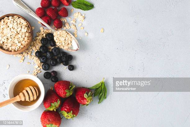 organic berries, oatmeal and honey - natural condition stock pictures, royalty-free photos & images