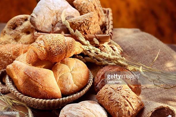 organic bread assortment - bun bread stock pictures, royalty-free photos & images