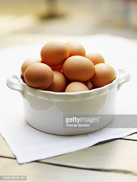 Organic brown eggs in bowl