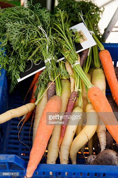 Organic carrots in a crate at the market