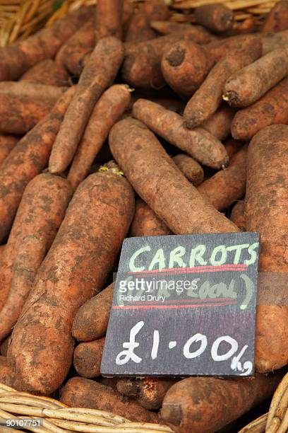 organic carrots on market stall - richard drury stock pictures, royalty-free photos & images