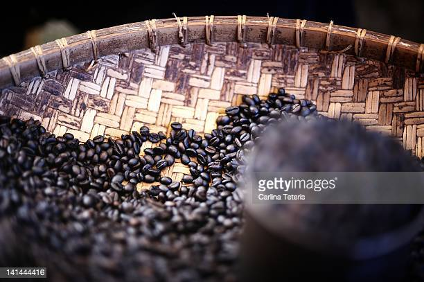 organic coffee beans in traditional wicker tray - rantepao stock photos and pictures