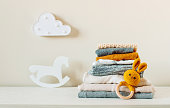 Organic cotton baby clothes on the shelf