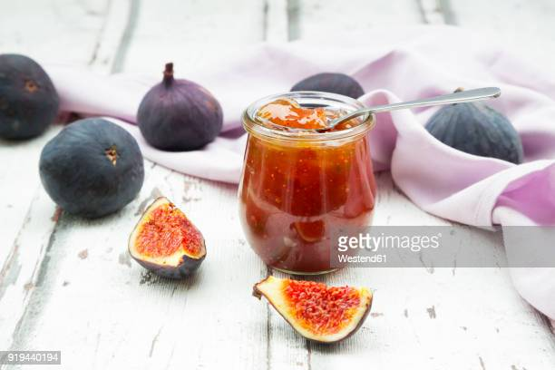 organic figs and a glass of fig jam on a wood - jam stock pictures, royalty-free photos & images