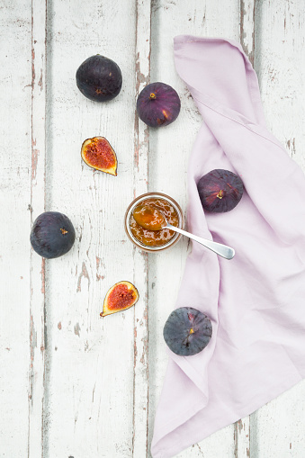 Organic figs and a glass of fig jam on a wood - gettyimageskorea