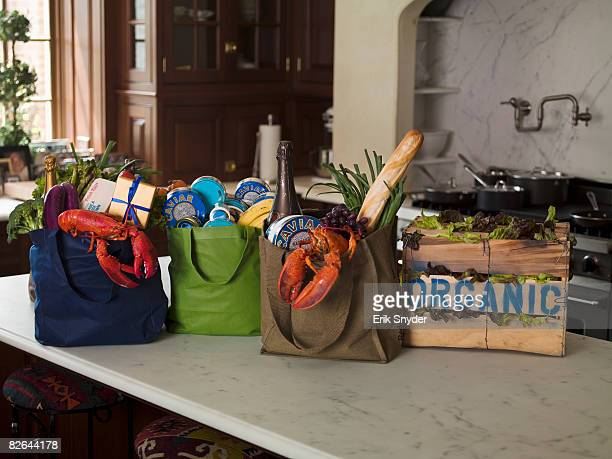 Organic groceries on counter of estate kitchen.