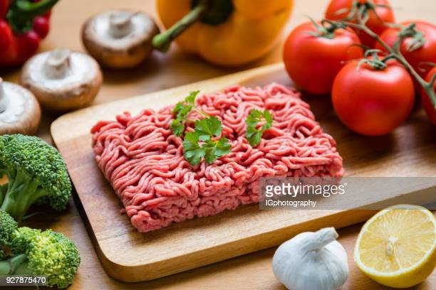 Organic Ground Beef on a Wooden Cutting-Boad