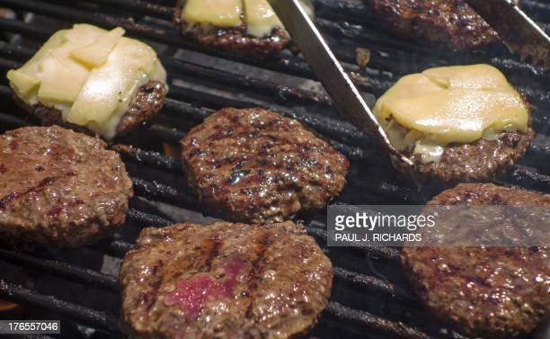 Organic hamburgers are grilled at a outdoor Farmer's Market August 15 in Washington, DC. AFP Photo/Paul J. Richards