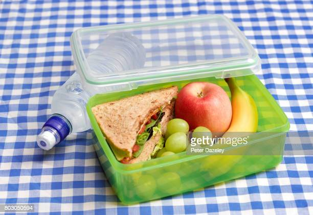 Organic healthy lunch box on a table cloth