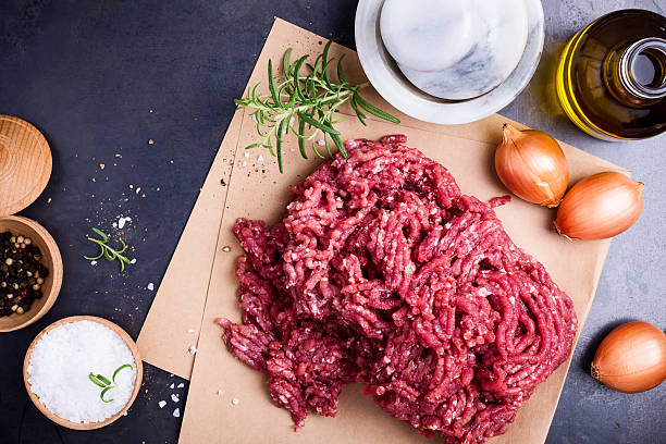 organic homemade minced meat on craft paper - ground beef & raw  stock pictures, royalty-free photos & images