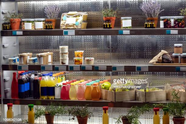 organic juices on refrigerator shelfs - sweet food stock pictures, royalty-free photos & images