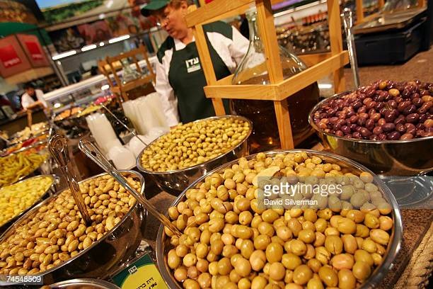 Organic olives are readied for sale at the Eden Natural supermarket which officially opens later this week June 11 2007 in Netanya central Israel...