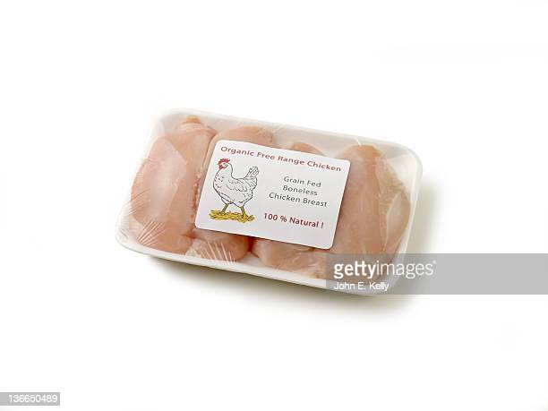 Organic packaged chicken breasts on white