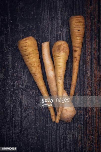 Organic Parsnips on Rustic Background