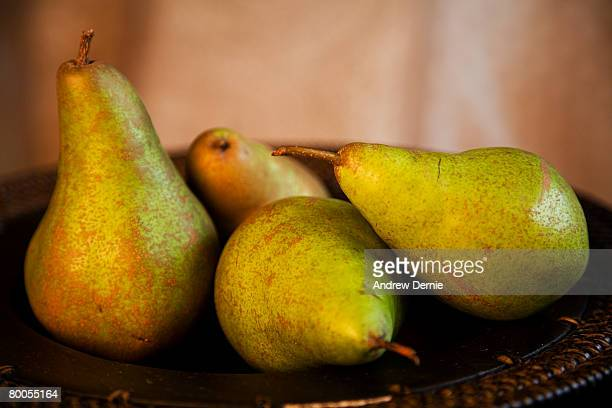 Organic Pears in a wooden bowl.