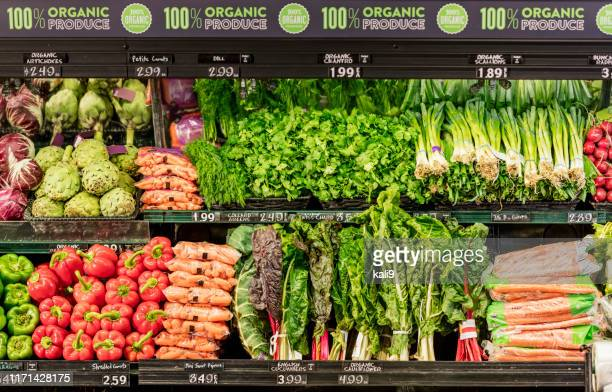 organic produce in grocery store - produce aisle stock photos and pictures