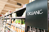 Organic products grocery category aisle at supermarket