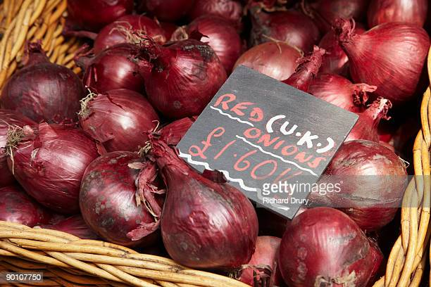Organic red onions on market stall