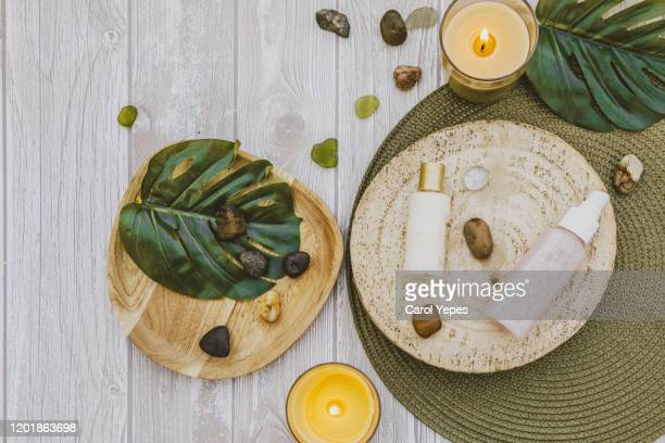 organic spa cosmetic on wooden background - wellness stock pictures, royalty-free photos & images