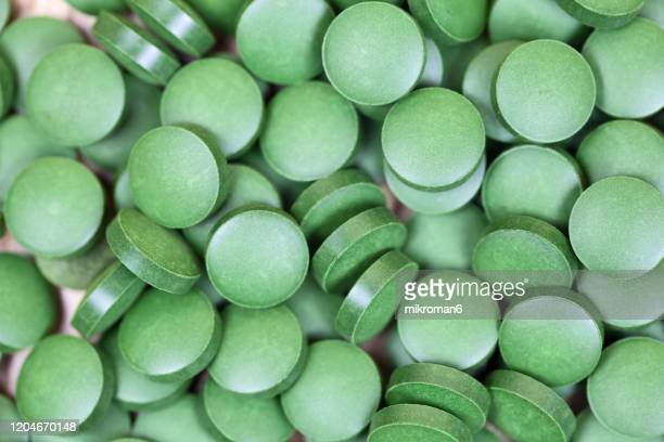 organic spirulina (blue-green algae) - chlorophyll stock pictures, royalty-free photos & images