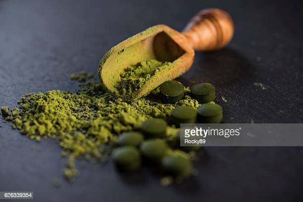 organic spirulina powder and tablets - homeopathic medicine stock photos and pictures