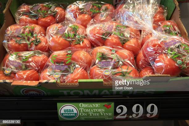 Organic tomatoes are offered for sale at an Aldi grocery store on June 12 2017 in Chicago Illinois Aldi has announced plans to open 900 new stores in...
