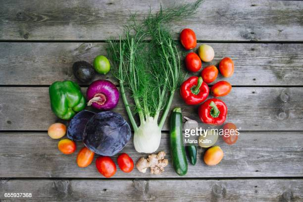 Organic vegetables and fruits on wooden background