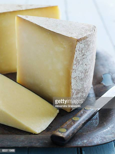 organic vermont cheddar cheese - cheese stock photos and pictures