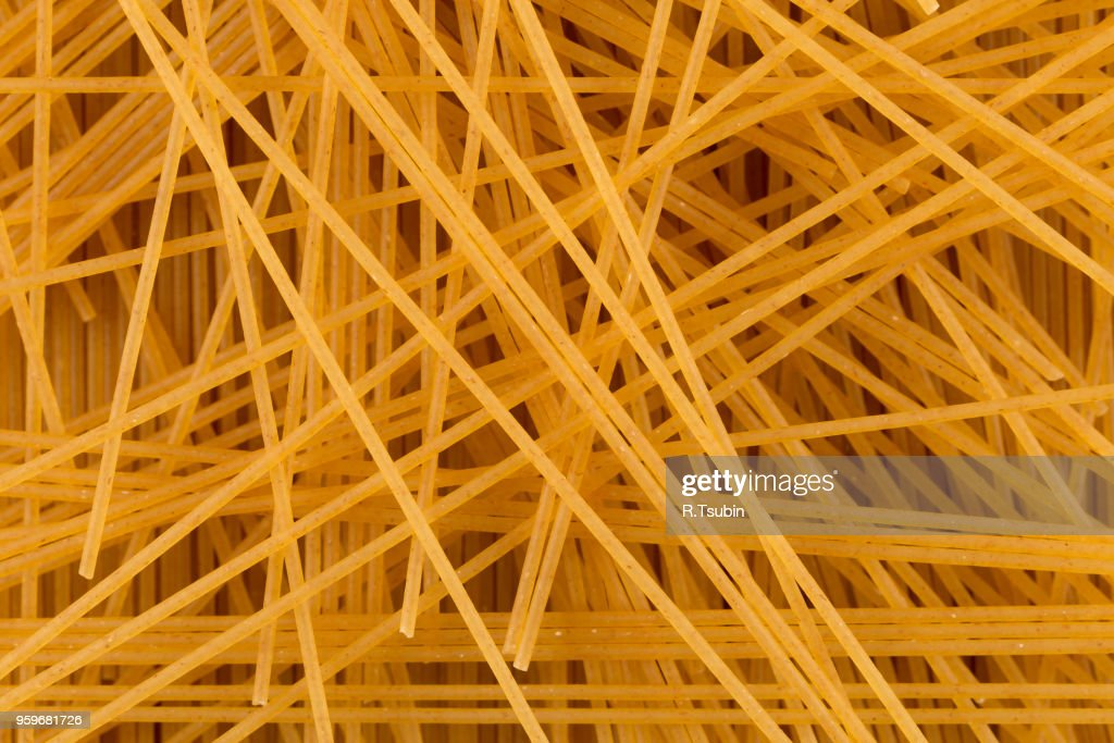Organic whole wheat spaghetti pasta for background : Stock-Foto