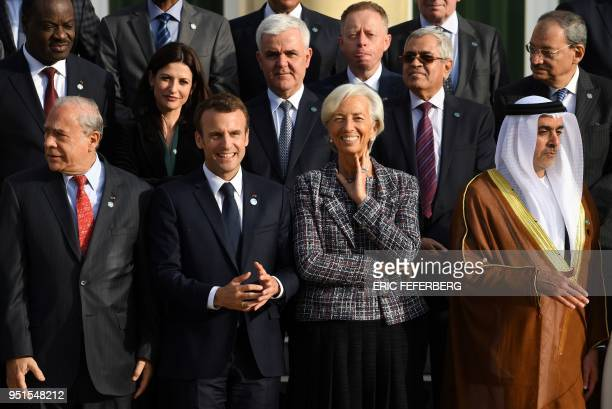 Organisation for Economic Co-operation and Development Secretary-General Angel Gurria, French President Emmanuel Macron, International Monetary Fund...