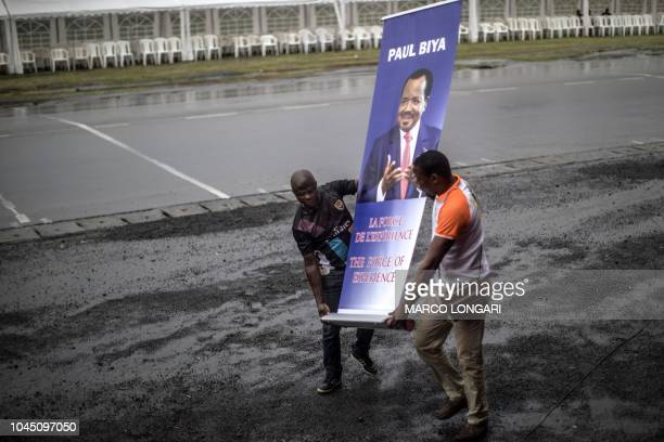 Organisers move a picture during a political rally of the ruling CPDM, Cameroon Pepole's Democratic Movement of incumbent Cameroonian President Paul...