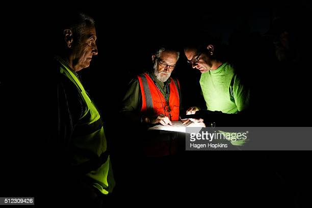 Organisers read a map prior to the launch of hot air balloons during the 2016 Wairarapa Balloon Festival on February 26 2016 in Carterton New Zealand...
