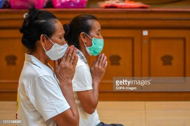 Organisers wearing face masks as a preventive measure take part during the online streaming Vesak Day prayers. Buddha Dharma temple held social media...